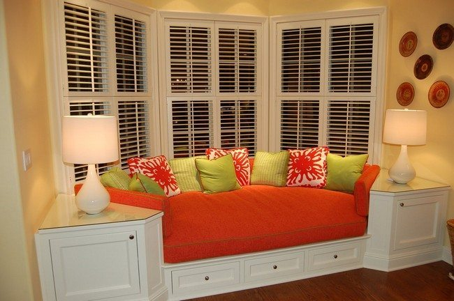 white curtains and red sofa with white nook