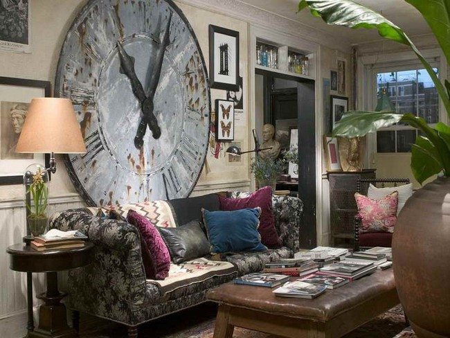 big clock ont the wall under bohemian sofa