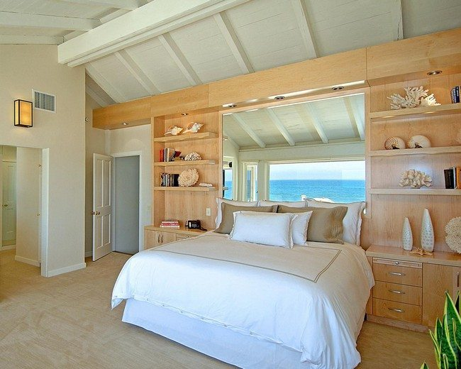 design looks loke on the ship or boat. big white double bedroom and wooden cabinet