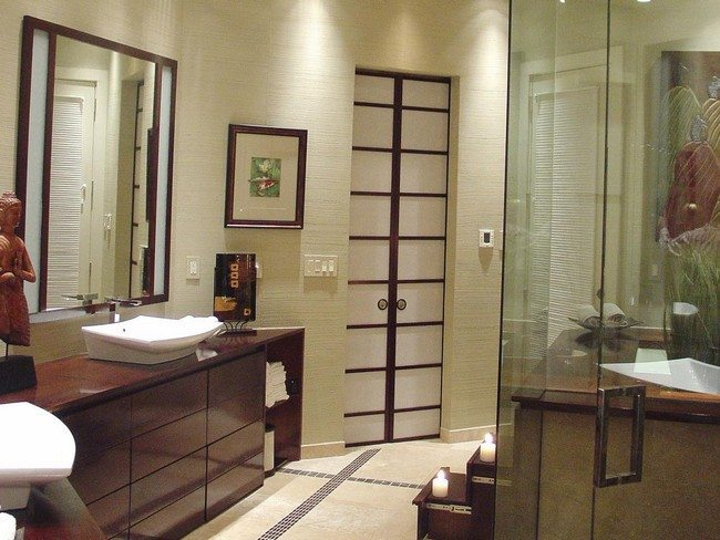 brown bamboo sink and glass shower
