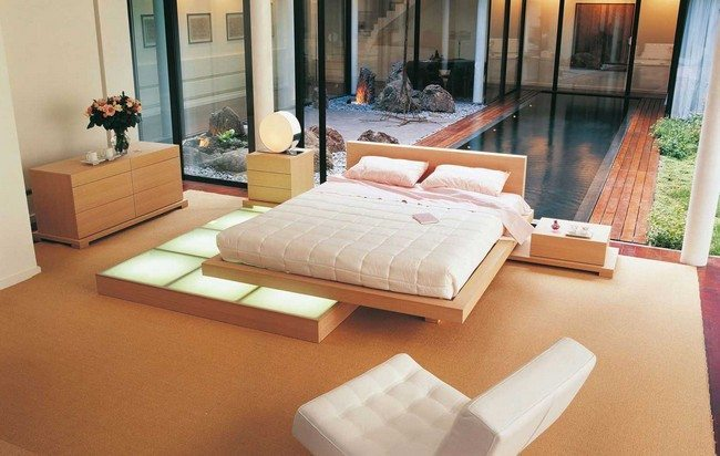 double bed in the light colors with softa armchair