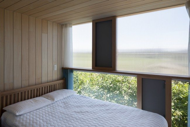 wooden ceiling and walls with double bed
