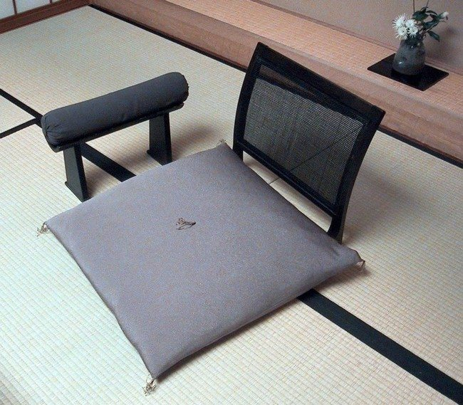 modern japanese hi tec armchair of grey color with armrest