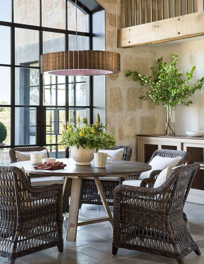 chairs made from stroke and green flowers in the kitchen with french windows