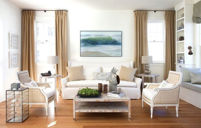 amasing coastal living with white loveseat and rustic armchairs on glossy wood laminate floor