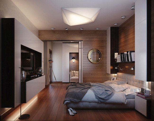double bed on the wooden laminated floor without windows