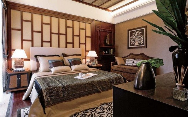 feng shui asian inspired decorating with king size classic bed and chesterfield sofa with stone vase