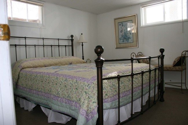 iron bed frame with double matrasse on it