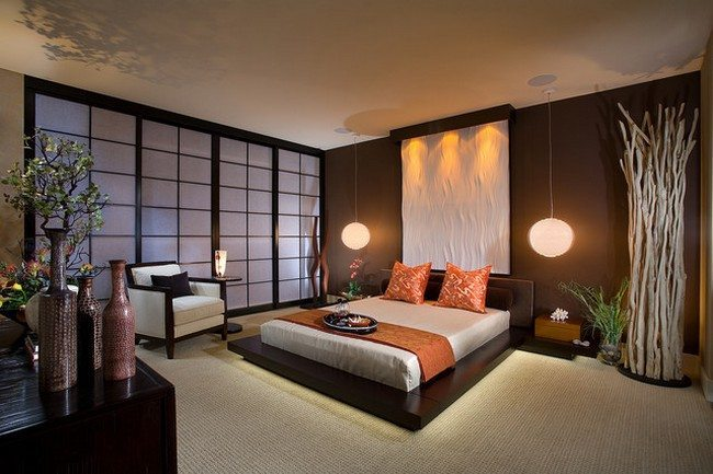 cosy style room with carpet on the floor and white wooden armchair with orange pillows and duvet