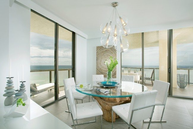 innovative coastal dining rooms with photo of coastal big windows and big roun table with white soft armchairs