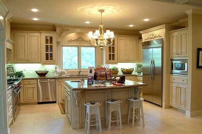 interior-cream-wooden-kitchen-island-with-brown-counter-top-and-white-wooden-stools-plus-white-wooden-cabinet-on-the-cream-floor with metal fridge