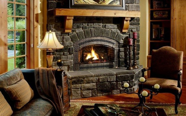 black stone corner fireplace with 2 chairs and one lamp giving bright light