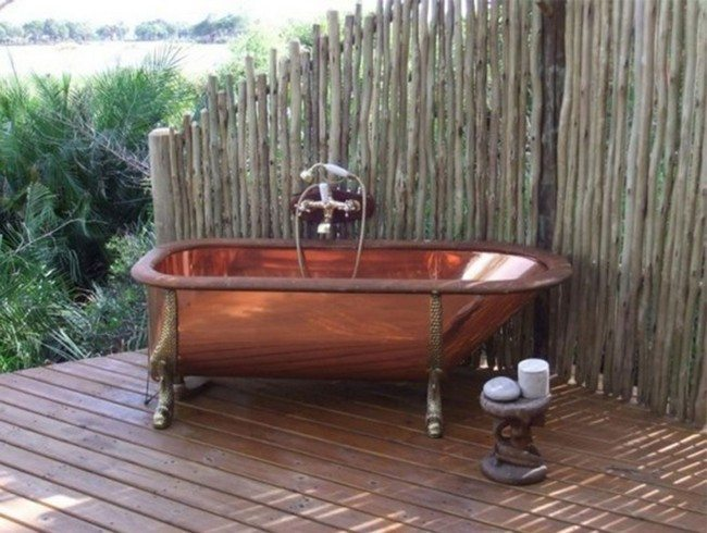 bamboo fence surround the bathroom . brouw red sink on the wooden dloor
