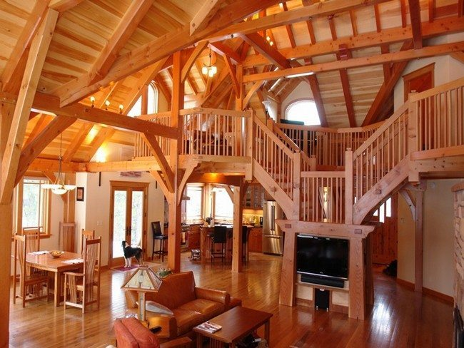 wooden living room with ledders anf wooden attic