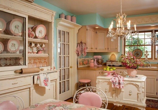 rose style kitchen with green walls,plenty of small puppets on the cup board