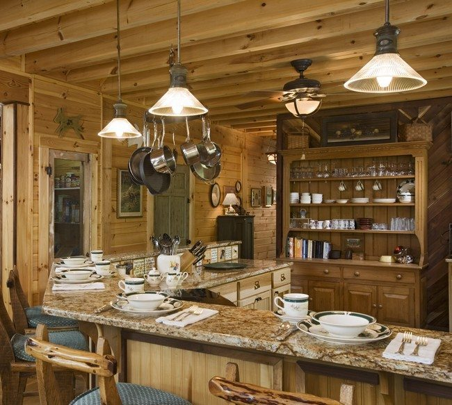kitchen wit wooden beamc on thew ceiling, wooden cabinet and table od the dark colour