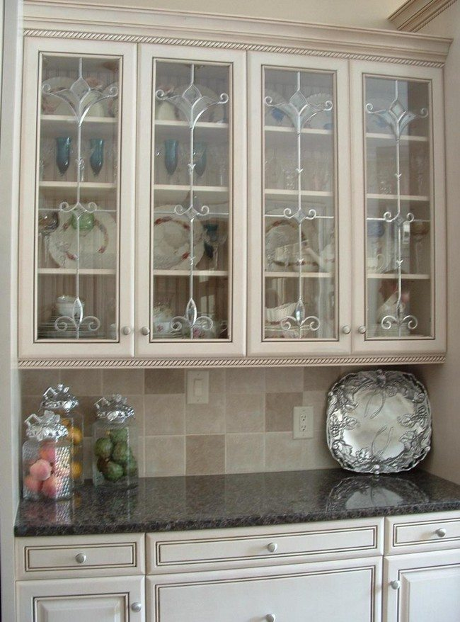 Ideas on installing the best frosted glass cabinets in your kitchen with well patterned regions and shiny elegant utensils visible through the glass planetlyrics Images