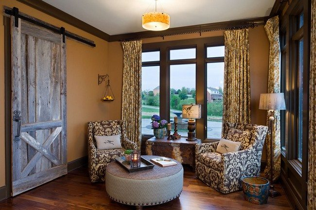 wooden floor anf som curtains with wooden door and two soft bright armchairs