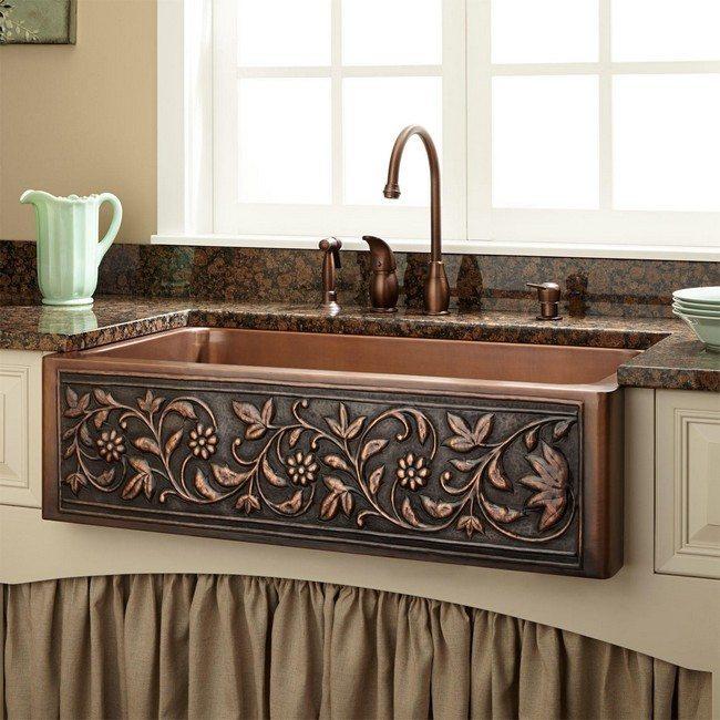 Bronze sink in the kitchen in front of window