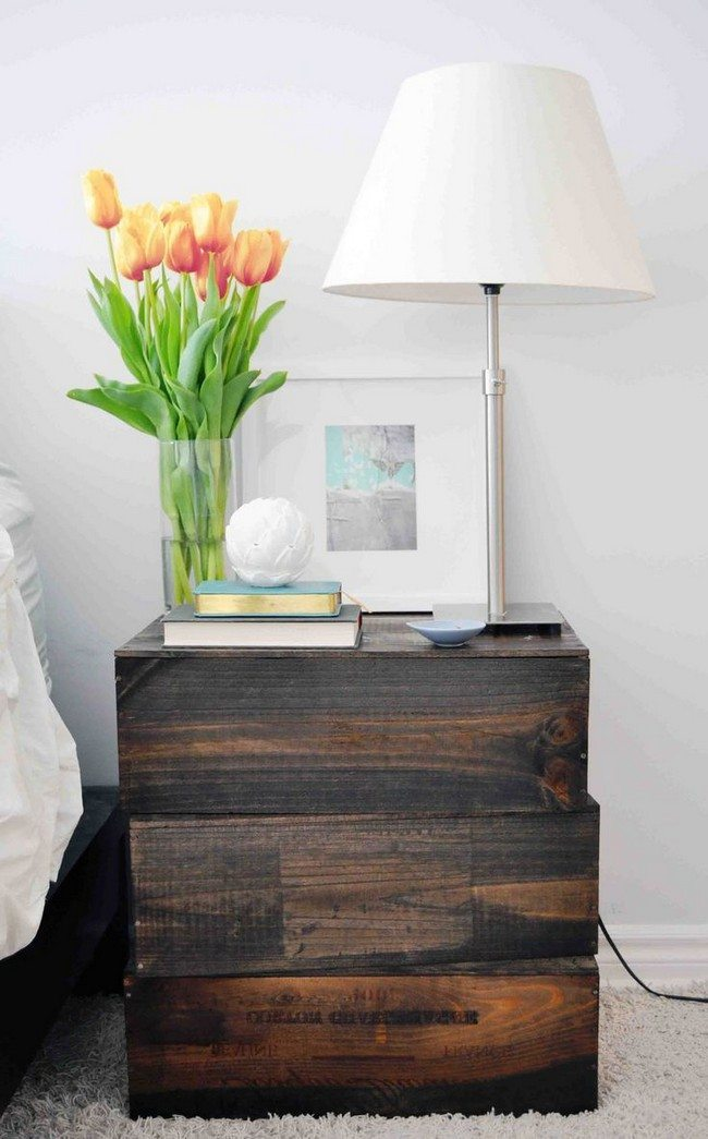wooden nightstand made from oak with banch of tulips