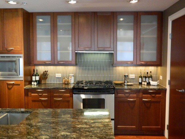 A well decorated kitchen with ample storage space