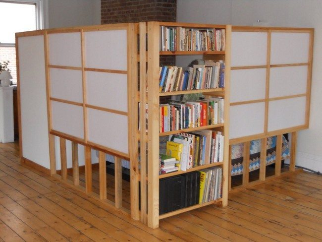 studio divider made from wood with sheleves for books