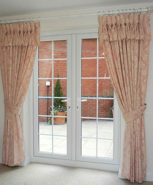 french door to the backyard with light curtains holding by ropes