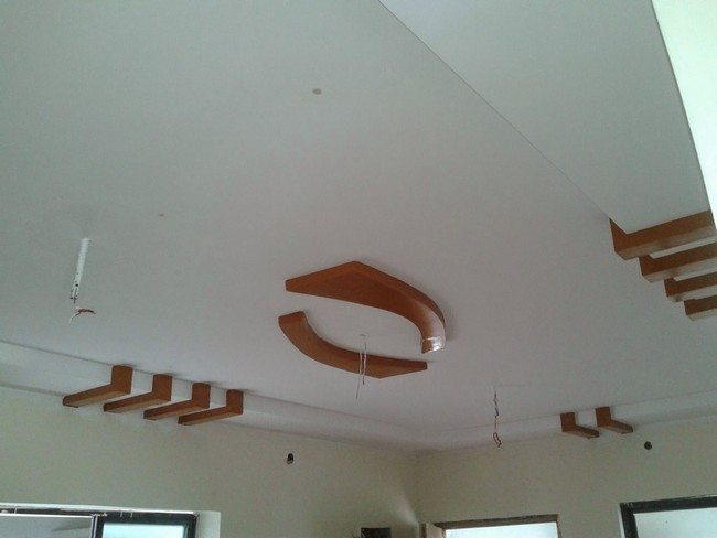 white ceiling with wooden chahdlier