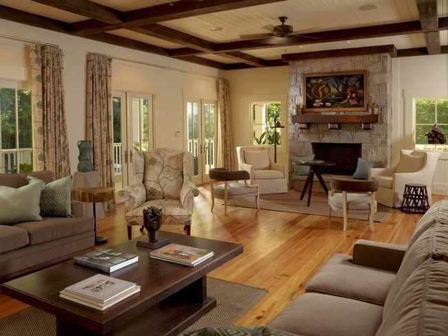 wooden floor with sofat sofa and fireplace and wooden decorativ beam under the ceiling