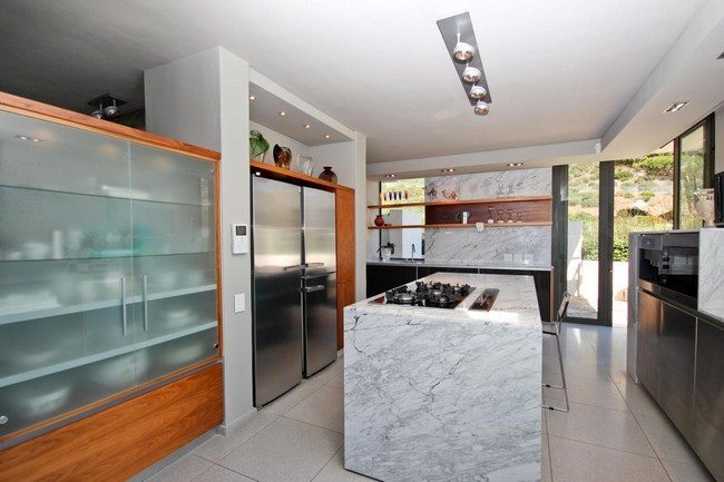 Large rectangular kitchen with distinct cooking and storage areas