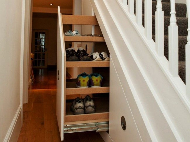 drawers with footwear under the wooden stair