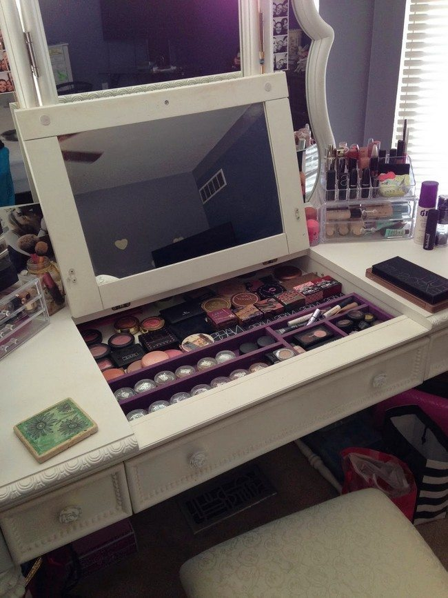 mirrored makeup storage for with two mirrors on the white wooden table