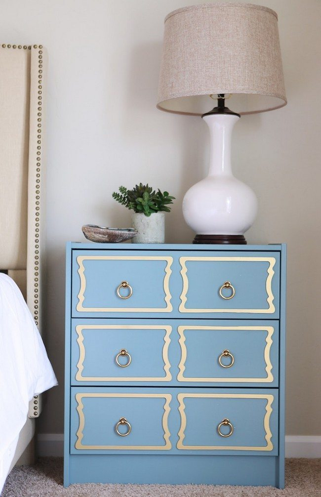 classic blue night stand with the lamp on it