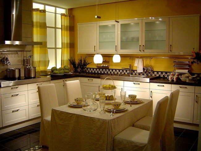 A bright and well-decorated kitchen with a midsection for the dining area