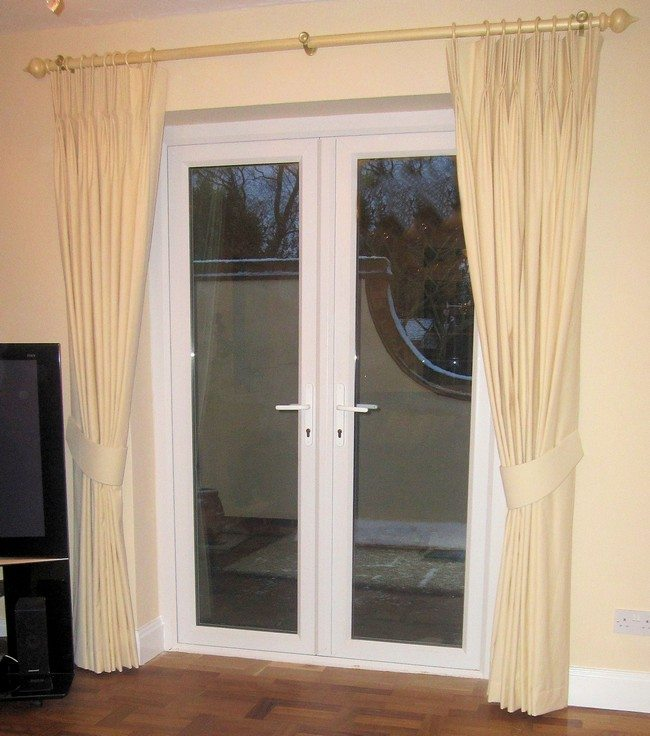 plastic french doors with white curtains