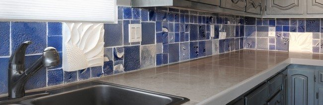 blue color brick splashes in the marble kitchen