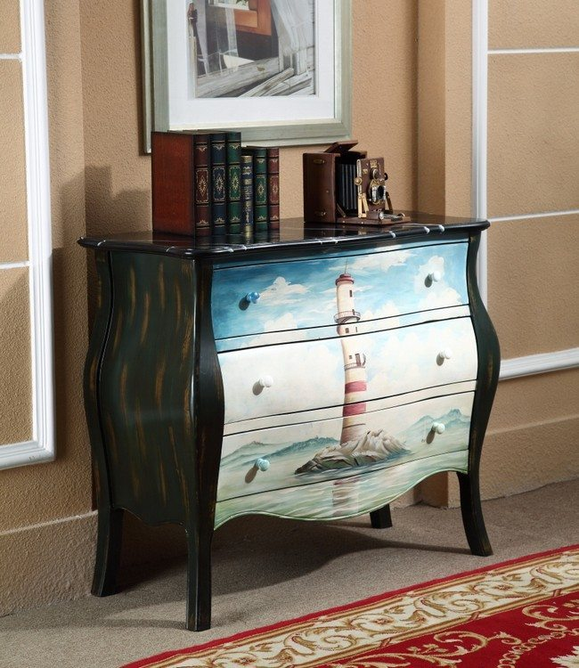 nightstand with the picture of a lighthouse on it with three drawers