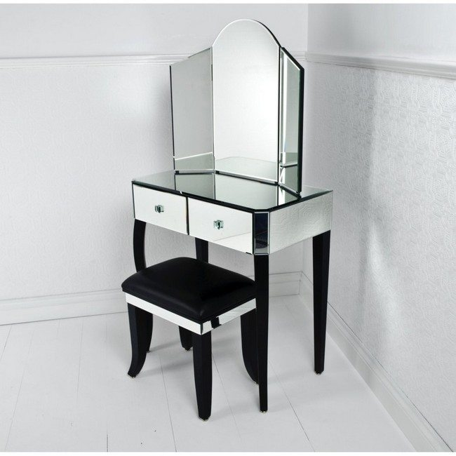 Small white mirrored makeup storage table with black chair