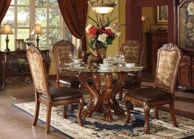 round glass table with awsome legs and four chairs with soft leather seats