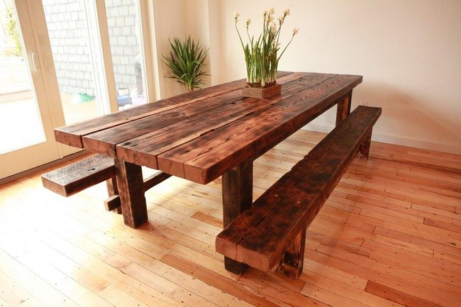 Brown table with two benches as element of the decor