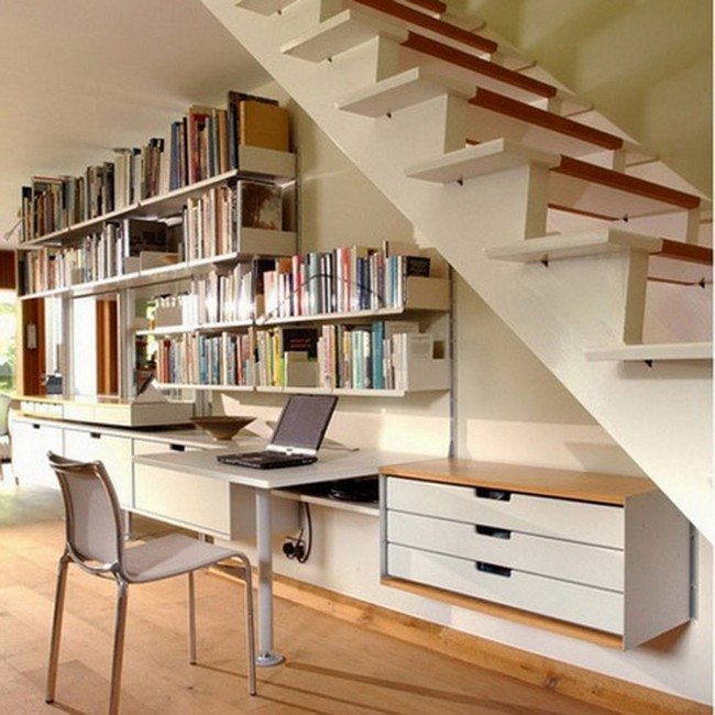 sheleves with books under the home stair