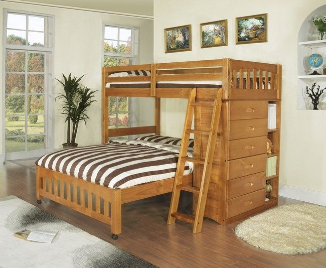 pine bank bed with striped matrasse on it and chest of drawers ont he right side
