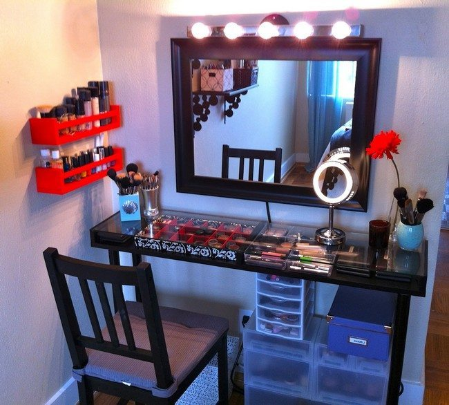 mirrored makeup table made drom wood with surface from glass with cosmetics under it