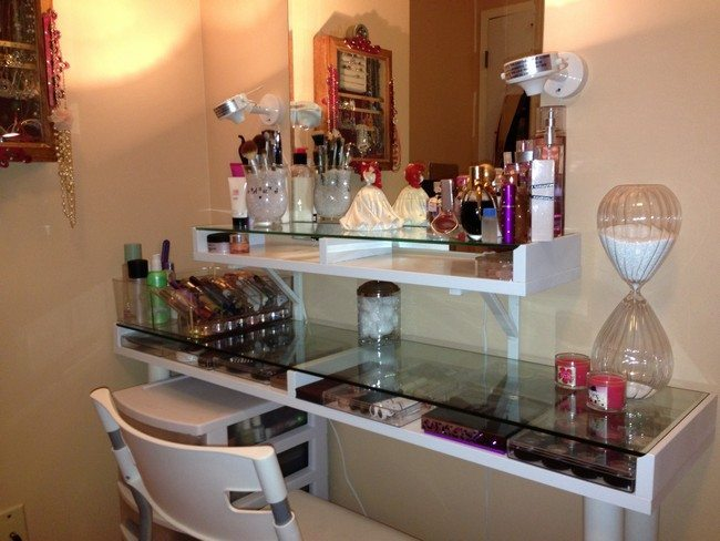 vanity table for small space. mirrored makeup table with glass surface and cosmetics on the shelf it Mirrored Makeup Storage is a Stylish Way to Unclutter The Vanity