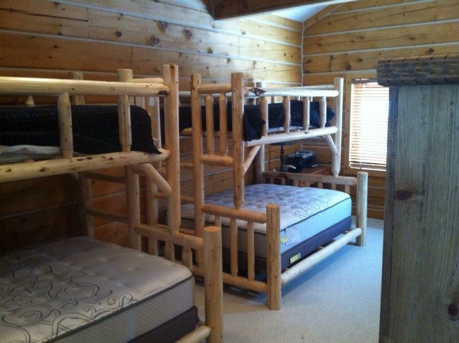 adult hostel with 2tow double bank beds made from cleared wood