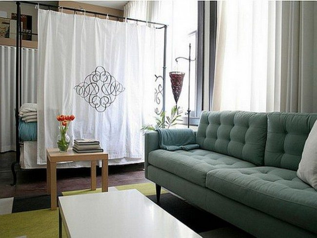 white curtain as a divider itne h room with green sofa