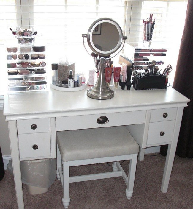 white wooden makeup storage with toe drawers on the side and small round mirror