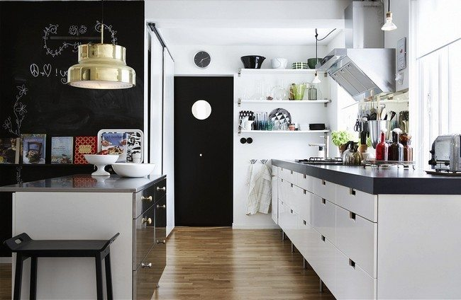 black door to the kitchne white glass round windo in the middle with white boards with wooden laminated floor
