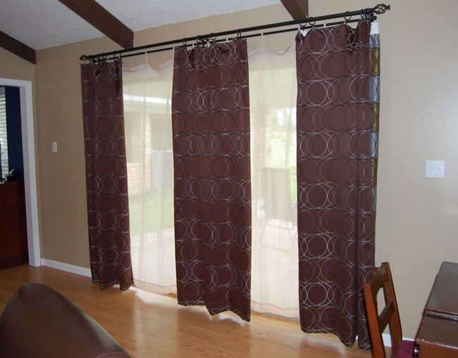 two frecnh doors with three brown curtains
