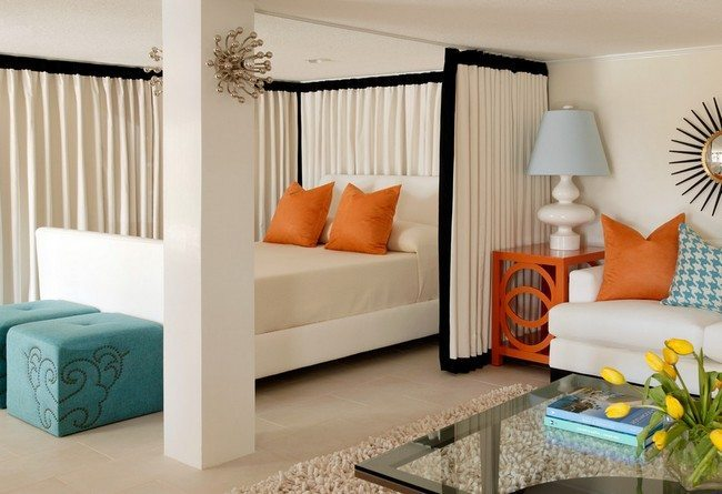 white curtain as a room divider for a double bed